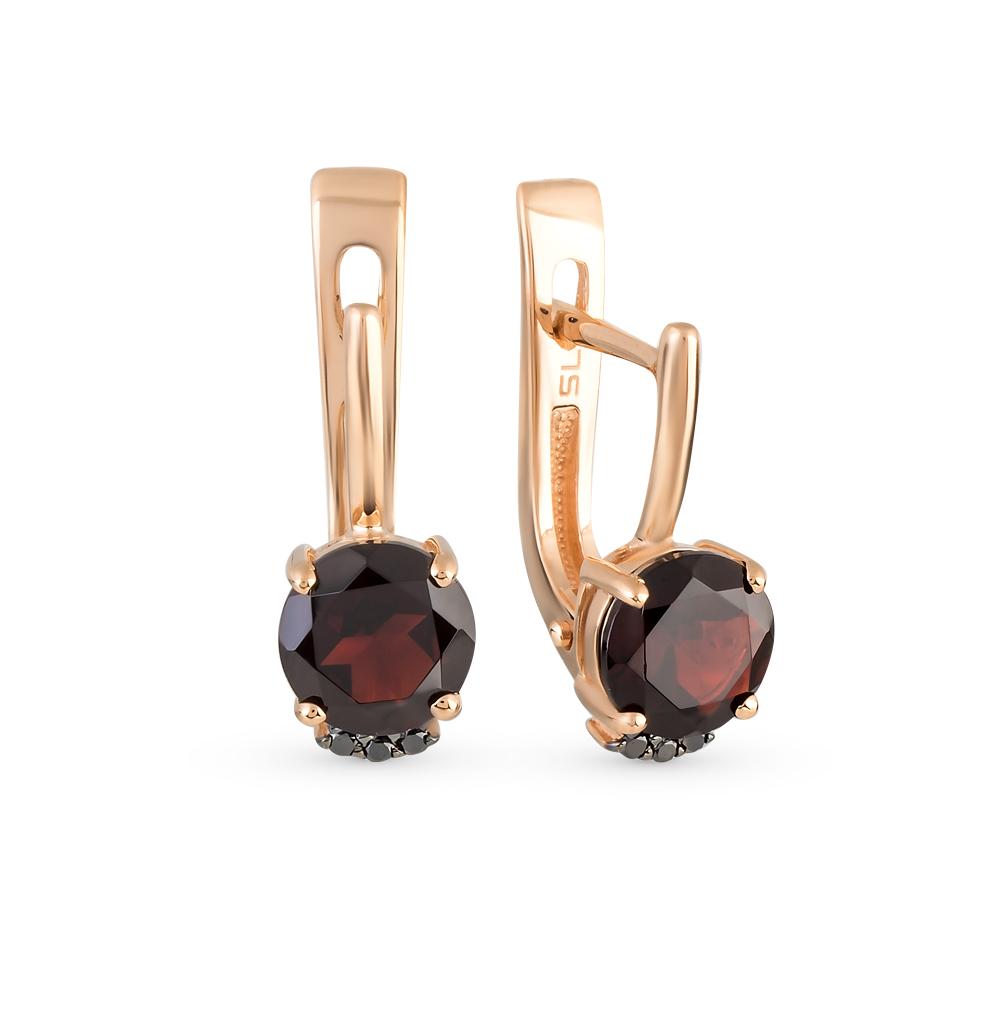 Фото «золотые серьги с чёрными бриллиантами и гранатом»