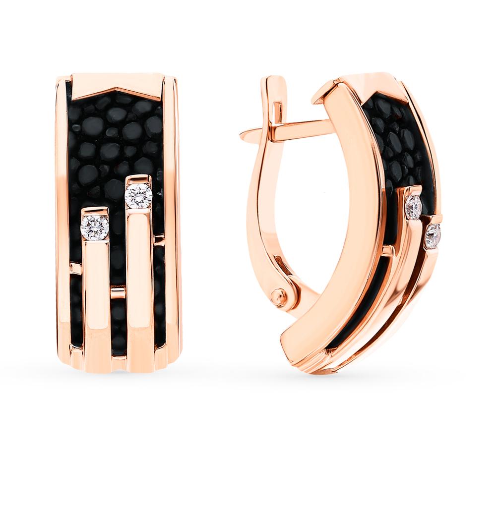 Фото «Золотые серьги с кожей и бриллиантами»