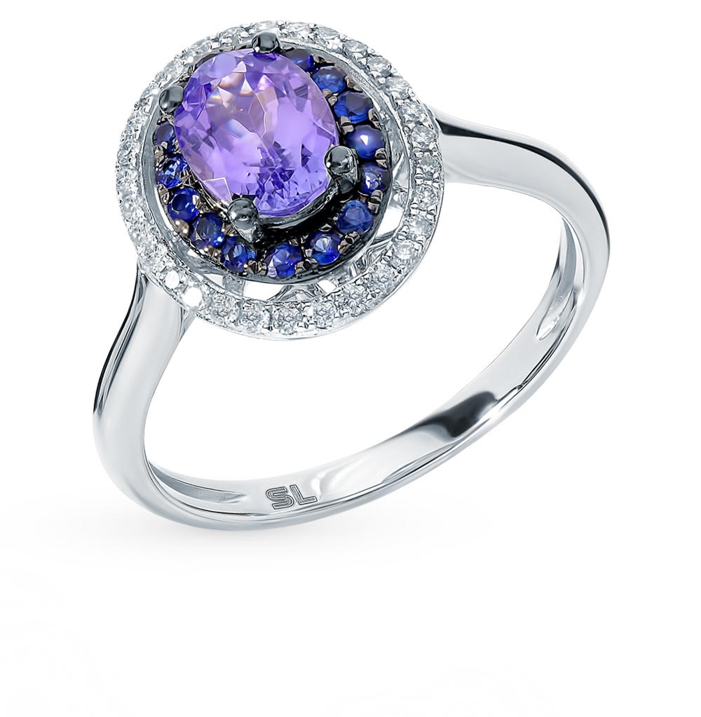 золотое кольцо с танзанитом, сапфирами и бриллиантами