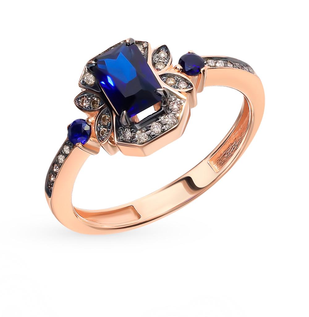 Фото «Золотое кольцо с коньячными бриллиантами и сапфирами»