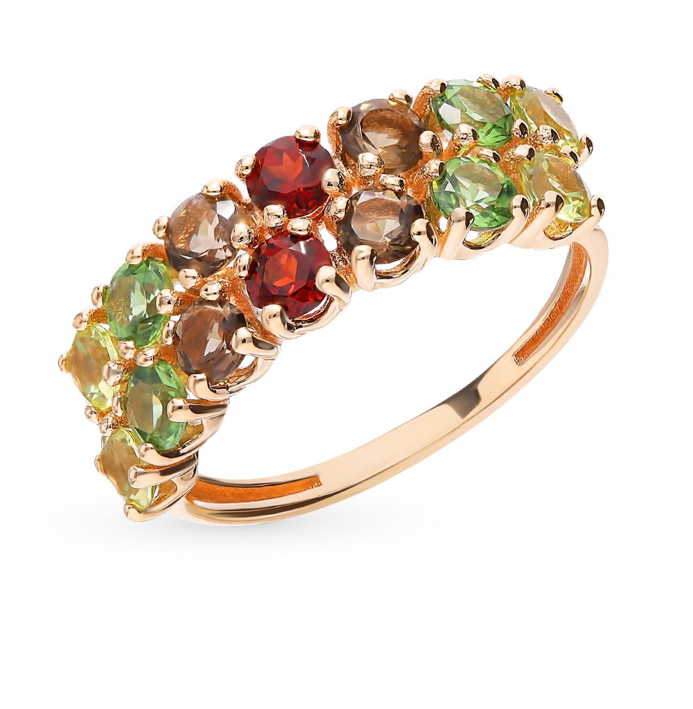 золотое кольцо с гранатом и раухтопазами (кварцами дымчатый)