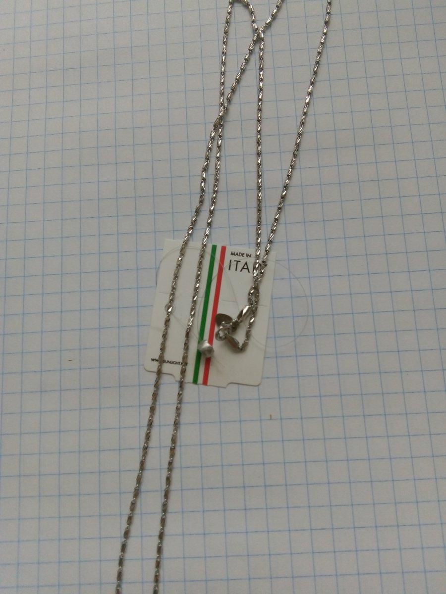 Серебряная цепочка из граненых боченочков.