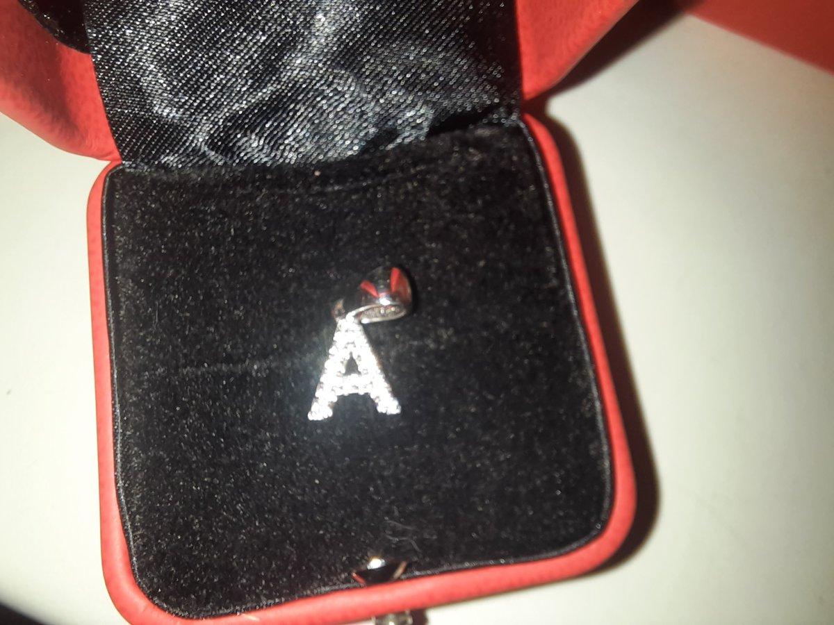 Подвеска из серебра с фианитами в форме буквы а