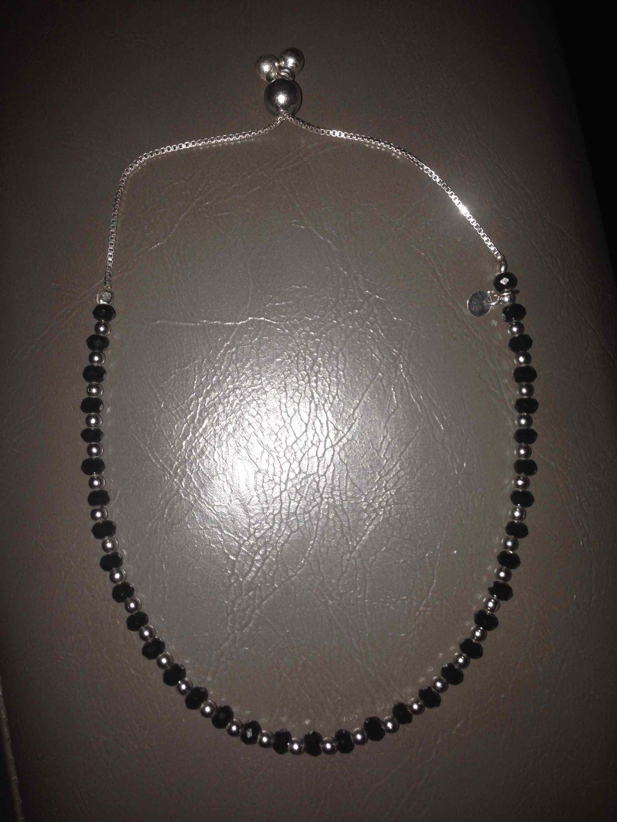 Серебряный браслет с черными бусинами из алпанита